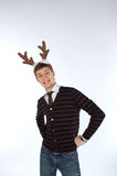 Young man wearing deer's horns Stock Photo