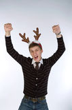 Young man wearing deer's horns Stock Photos