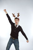 Young man wearing deer's horns Royalty Free Stock Images