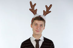 Young man wearing deer's horns Stock Image