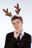 Young man wearing deer's horns Stock Images