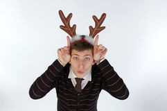 Young man wearing deer's horns Stock Photography
