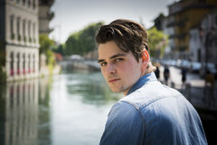 Young man wearing denim shirt on city bridge Royalty Free Stock Images