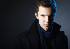 Young man wearing elegant black suit Stock Photos