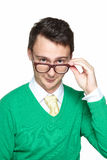 Young man wearing eyeglasses. Positive young man adjusting his eyeglasses. Smiling nerd looking at the camera over his glasses stock photos