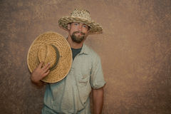 Young man wearing a fashionable straw hats Stock Photos
