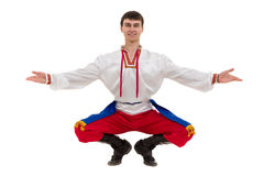 Young man wearing a folk costume posing against isolated white with copyspace Royalty Free Stock Photography