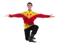 Young man wearing a folk russian costume dancing against isolated white with copyspace Royalty Free Stock Photo