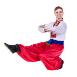 Young man wearing a folk russian costume dancing against isolated white with copyspace Stock Photos