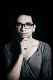 Young man wearing a glasses Royalty Free Stock Images