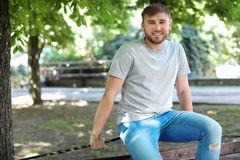 Young man wearing gray t-shirt in park. Urban style Royalty Free Stock Photos