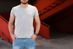 Young man wearing gray t-shirt on street. Urban style Royalty Free Stock Photography