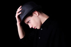 Young man wearing a hat over black Stock Photography