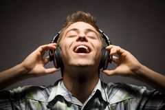 Young man wearing headphones Stock Image