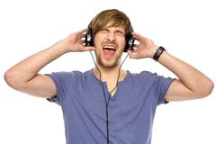 Young man wearing headphones Stock Images