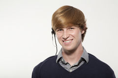 Young Man Wearing a Headset Stock Images