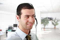 Young man wearing a headset at the office Royalty Free Stock Photos