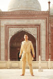 Young man wearing indian clothes. Confident caucasian young man wearing indian clothes in Taj Mahal, India royalty free stock image