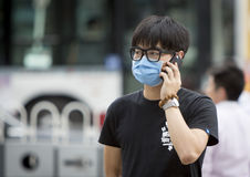 Young man wearing mask Stock Image