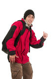 Young man wearing red winter coat hitchhiking Royalty Free Stock Images