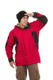 Young man wearing red winter coat posing looking Royalty Free Stock Image
