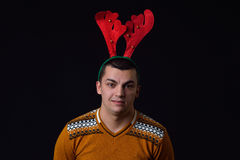 Young man wearing reindeer horns with funny expressions. Funny i Royalty Free Stock Photo