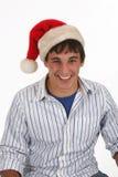 Young Man Wearing Santa Hat. Young man wearing Christmas Santa Claus hat. Season spirit Royalty Free Stock Photos