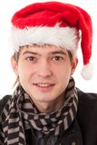 Young man wearing Santa hat Royalty Free Stock Images