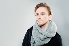 Young Man wearing Scarf Stock Images