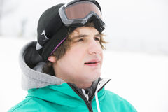 Young man wearing ski goggles outdoors Stock Photos