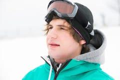 Young man wearing ski goggles outdoors Stock Photos
