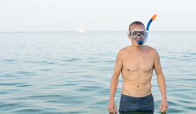 Young man wearing a snorkel and goggles Royalty Free Stock Images