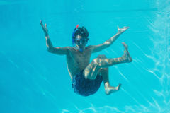 Young man wearing snorkel underwater Royalty Free Stock Photos