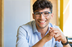 Young man wearing spectacle. Closeup shot of young man wearing spectacle. Portrait of a guy with shirt and eyeglasses looking at camera indoor. Handsome smiling royalty free stock photo