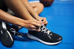 Young man wearing a sports shoes royalty free stock photography