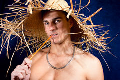 Young man wearing a straw hat Stock Photo