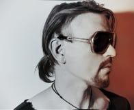 Young man wearing a stylish sunglasses Stock Photography