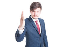 Young man wearing suit standing with one hand up. Like a constraint isolated on white background with copy text space Royalty Free Stock Photo