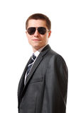 Young man wearing a suit and sunglasses Stock Image