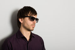 Young man wearing sunglasses Stock Photography