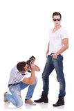 Young man wearing sunglasses being photographed Stock Photography