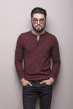 Young man wearing sunglasses and a burgundy sweater Stock Photography