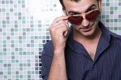 Young man wearing sunglasses, portrait, close-up Stock Photography