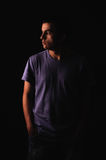 Young man wearing t-shirt standing with hands in poc Royalty Free Stock Images