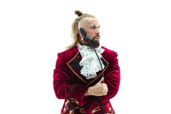 The young man wearing a traditional medieval costume of marquis. Posing at studio with whip. Fantasy, Antique, Renaissance concept royalty free stock photos