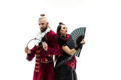 The young man wearing a traditional medieval costume of marquis and woman as marquise. The young men wearing a traditional medieval costume of marquis posing at royalty free stock photos