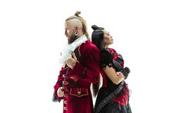 The young man wearing a traditional medieval costume of marquis and woman as marquise. The young men wearing a traditional medieval costume of marquis posing at stock photography