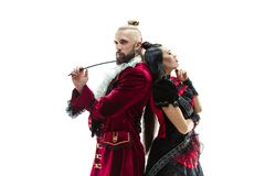 The young man wearing a traditional medieval costume of marquis and woman as marquise. The young men wearing a traditional medieval costume of marquis posing at royalty free stock photography