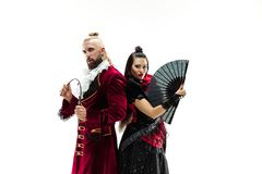 The young man wearing a traditional medieval costume of marquis and woman as marquise. The young men wearing a traditional medieval costume of marquis posing at stock photo