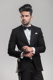 Young man wearing a tuxedo, looking away from the camera Stock Images